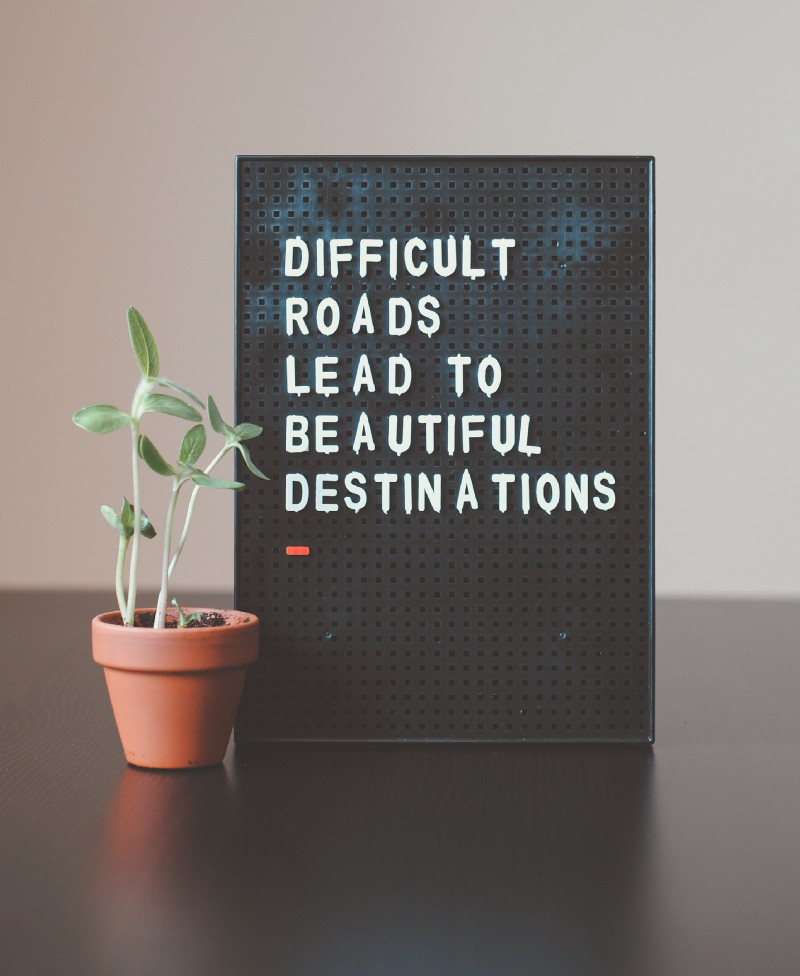 How I changed working hard to working smart - A sign that says: Difficult Roads Lead To Beautiful Desttinations.